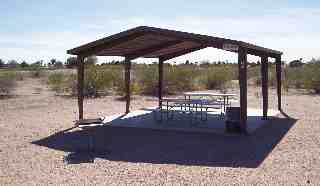 Ramada with benches and BBQ grill